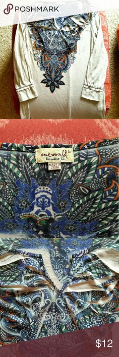 SALE****One World Blouse Size XL but I think it is more  Large. I am XL.  I can wear it comfortably but it is a little tighter than I like. Vneck with some embellishments below neck. Colors beige, blue, little rust, little green.  Really pretty. No spots or holes.  Minimal to medium wear. ONE WORLD Tops Blouses