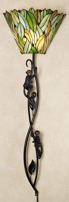 http://www.touchofclass.com/monkey-around-stained-glass-wall-lamp-green/p/X124-001/