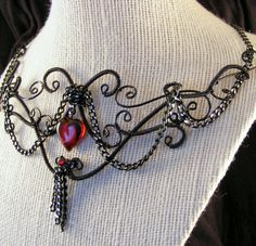 Black goth wire wrapped swirled necklace bib, statement with red heart. $52.00, via Etsy.
