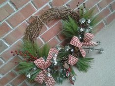 Grapevine Christmas wreath diy. Red chevron burlap ribbon. All purchased from hobby lobby. :) Super easy!!!
