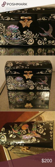 EXUISITE JEWELRY BOX Black super shiny black lacquer wooden JEWELRY box with authentic mother of pearl designs pearl & colors of koi fish & crane birds with a gold butterfly closure lock.truly one of a kind & EXUISITE for the CLASSY lady who loves to hold her precious treasures!Like NEW in MINT CONDITION! Red velvet interior,two compartments top is a removable draw.This rare and unique JEWELRY box was gently used by me with TLC.1 minor interior scratch. Mother of Pearl Jewelry