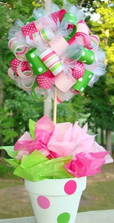 Ribbon ... Easy to do centerpiece for parties! This would be cute for a baby shower