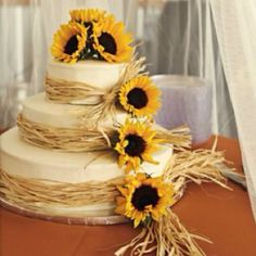 Sunflower and raffia cake decoration.