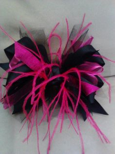 Pink & black bow with feathers I made.