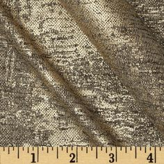 Telio Reflection Hatchi Knit Gold from @fabricdotcom  This fine gauge hatchi jersey sweater knit fabric is perfect tops, sweaters, T-shirts, and comfy knit apparel. It features a metallic gold foil print and four way stretch-25% vertical, 40% across the grain.