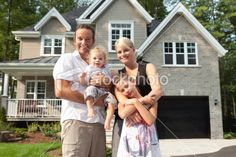 Happy Family In Front Of Their New House Royalty Free Stock Photo