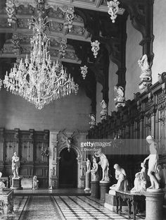 Statues in the Great Hall at Harlaxton Manor (also known as Grantham Castle) in Harlaxton, Lincolnshire, April 1948. The manor house was built for Gregory Gregory between 1837 and 1845. The house was designed by architects Anthony Salvin and William Burn, with interiors by David Bryce.