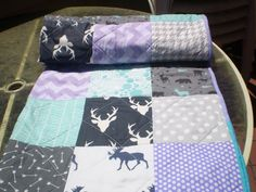 A stunning color combination in a woodland theme!! This adorable rustic woodland themed patchwork baby quilt measuring 36 X 48 in purple, teal and