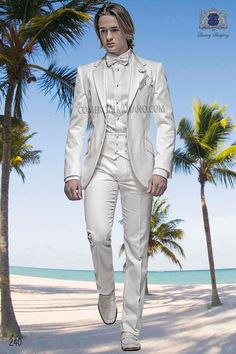 White cotton pique suit with notch lapel with 2 buttons closure. Flap pockets and straight buttonholes. Twin vents at back, style 240 Ottavio Nuccio Gala, 2015 Fashion Collection.