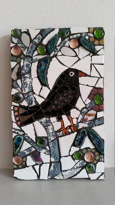blackbird on tree mosaic. I love the use of patterned materials for the trunk and branches! Mosaic Garden Art, Mosaic Tile Art, Mosaic Artwork, Mirror Mosaic, Mosaic Crafts, Mosaic Projects, Stone Mosaic, Mosaic Glass, Mosaic Ideas