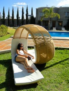 A loop-shaped lounger dubbed Loopita Bonita by Victor M. Aleman was inspired by curves of a rollercoaster what creates its dynamic look. The loop ends with two seated benches. A perfect outdoor lounger for all sun-loving couples.