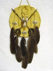 Native American Made Small Ceremonial Medicine Man Shield with Medicine Bag - This Medicine Man Shield represents peace and powerful medicine. It is wrapped in genuine buckskin. Two crossed arrows representing peace, are displayed in the center. The medicine bag should be filled with white sage and sacred stones. Feathers and leather color will vary. Certificate of Authenticity included.  Dimensions: 14 in. diameter x 32 in. long.  $124.95