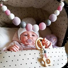 This pram garland is coming with hanging toy that you can take off and it will become a teether for your little one. Beads are safe for teething as they are made from 100% food grade silicone and natural wood. Your baby will surely like it