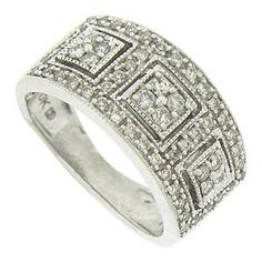 A trio of abstract style flowers are framed in squares of milgrain on the face of this handsome estate wedding band. Rows of fine faceted diamonds surround the sparkling floral figures. The wedding ring is set with approximately .60 carats of fine faceted diamonds and fashioned of 10K white gold. The ring measures 10. mm in width. Circa: 1950. Size 6. We can re-size.
