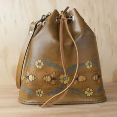 Art nouveau inspired bee and flower drawstring bag!  The handmade leather Bucket Bag in the Melissa pattern converts to a backpack.  Perfect every-day purse!
