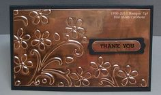 """By Anne Hayward. Use copper roof flashing. Emboss in dry embossing machine. Sentiment stamped on scrap piece of flashing using StazOn, then punched out with Word Window punch. Flashing comes in 12"""" x 20' roll & can be found in roofing section of Home Depot. Easy to cut with scissors, emboss, and punch. Has a cardboard backing that does not peel off."""