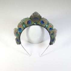 Make a statement with this peacock tiara headpiece handmade by Loschy Designs. Materials: cardboard, gems, peacock feathers, and fabris. Comfortable and lightweight----One size fits most Peacock Costume, Peacock Dress, Peacock Jewelry, Peacock Feathers, Peacock Print, Peacock Wedding, Tiaras And Crowns, Crown Jewels, Headpiece