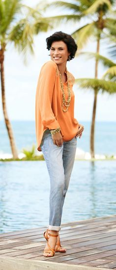 Get ready for summer travel with breezy blouses and statement necklaces. Summer fashion over 50   Summer outfit ideas   Summer necklaces #women'sfashionover50 #womensfashionclothingover50