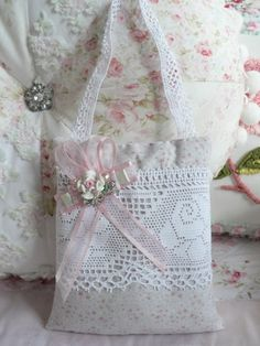 Shabby Cotttage Mary Rose lavender sachet along with lace, roses, rhinestone button, ribbons and pearls. By Our Shabby Cottage, via Flickr