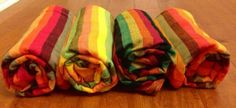 (Doing this for the giveaway! :)  Risaroo Exclusive Girasol Marley wrap comes in 4 wefts: black, yellow, orange and red!
