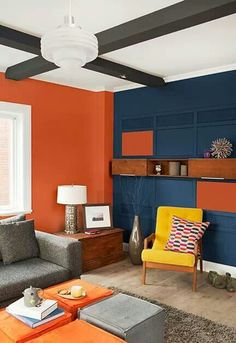 More Fabrics loves this Color Block Interior. These Red And Blue Walls are in perfect balance with the Yellow Chair. Colorful Interior Design, Interior Desing, Colorful Interiors, Bedroom Color Schemes, Bedroom Colors, Split Complementary Color Scheme, Deco Orange, Colour Blocking Interior, Trending Paint Colors