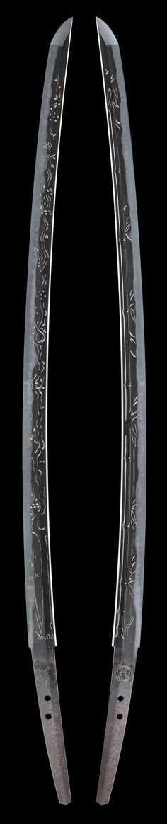 "Full length 'Kinai-Bori' or 'Echizen-Bori' carving on an Echizen katana. It appears to be inscribed with a name: ""Sword of the Last Days."""