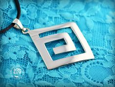 """""""The Best Guide"""" - a silver pendant representing the famous Greek motif - a maze which symbolizes life. The labyrinth is a symbol of a Cretan goddess Ariadne.  http://www.greekgoddessjewelry.com/en/shop/meandros-collection/pendants/product/136-pendant-iii-the-best-guide"""