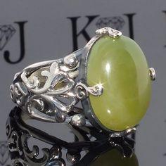 http://de.dawanda.com/product/102044039-silber-herrenring-mit-neon-idocrase-handgefertigt