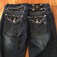 """SALE Miss Me Embellished Boot Cut Jeans Size 27 These are a gorgeous pair of boot cut jeans from Miss Me in a size 27.  They feature a 5 pocket design & have a rhinestone & beaded embellishment with lace inset along the back & back pockets and over the front right pocket.  They are made of 98% cotton & 2% elastane and they have a 27"""" waist with a 30"""" inseam.  Worn only once or twice they are in excellent condition. Miss Me Jeans Boot Cut"""