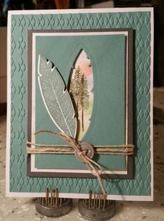 handcrafted card using Stampin up feather and die set. ... negative space filled with a woodland sunset scene ... wonderful!