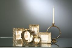 All That Glitters is gold. Picture frames and candle holders by Nima Oberoi Lunares.
