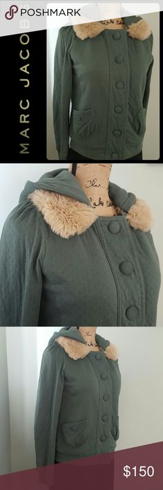 Marc Jacobs Hoodie Faux Fur Marc Jacobs Signature Hoodie Top in Gorgeous Teal Shade With Faux Fur Details! Very Soft and Warm in 100% Cotton with 2 Front Pockets Snap Button Close!   Main Front Buttons Design worry Hidden Snap Buttons Closure! Detachable Hoodie Leaving Just the Faux Fur Accent! Fleece Lined Interior for Added Warmth! Used in Mint Condition! Size M, Measures 19 Inches Pit to Pit Fiat! Marc Jacobs Tops Sweatshirts & Hoodies
