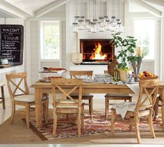 Would love a casual dining room like this. Could move my dining room into my living room for the fireplace, but it wouldn't have a chandelier.  Hmm...
