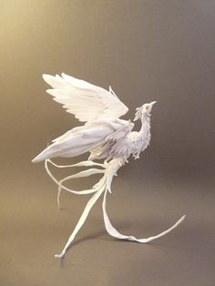 Snow Phoenix Sculpture, would make a pretty tattoo, but maybe in some soft colors, rising from swirling ashes.