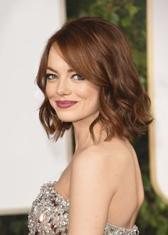 """The angled lob      """"A blunt cut with a hint of layers underneath creates nice movement,"""" says Emma Stone's hairstylist Mara Roszak."""