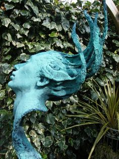 Poly-Chromed Resin #sculpture by #sculptor Lucy Kinsella titled: 'Ophelia (Semi abstract female Head Gatden sculpture)'. #LucyKinsella