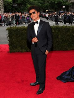 Swag master Bruno Mars at the entrance to the red carpet of the MET Gala in NYC. See full gallery here: http://bit.ly/ISkhB2