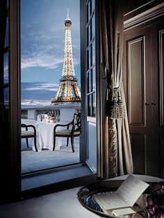 Eiffel Tower To stay in a hotel room in Paris with a view of the Eiffel Tower is a life goal!