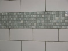 Subway Tile with dark grout and green mosaic glass accent.  Yes but with penny button accent instead