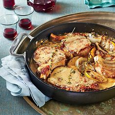 Skillet Pork Chops with Apples and Onions | Elegant and easy, this hearty dish comes with a side and a sauce all-in-one. Be sure to brown the chops well so they'll give the mustardy pan sauce deep flavor.