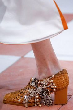 Céline's wicker basket midi heels came finished with pearl-studded brooches