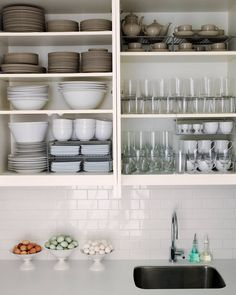 How to organize kitchen cabinets and drawers with large spaces for shelves for bowls plates glasses cups wood material made white color theme ceramic wall tap kitchen sink square shape kitchen desk elegant design ~ Home & Interior Decorating Ideas : Plapoon.com