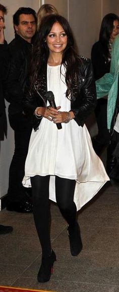 Who made Nicole Richie's white dress, black studded jacket and black boots that she wore in Sydney on June 17, 2010? Shoes – Christian Louboutin  Jacket – Simone Collection Studded  Dress – Uscari