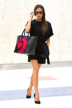 Victoria Beckham offsets an all-black ensemble with a colorful graphic bag. Shop her look here: