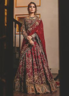 Red ghaghra choli bridal dress is designed with elegant work. Alluring red ghaghra choli designed with embroidery of dabka, zari, nagh, stones, sequins