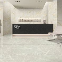 This modern Spa reception area features Rustic Jade and Ice Onyx marble effect porcelain tiles. #luxury #spa #design