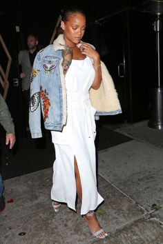 Rihanna leaves Bootsy Bellows in Hollywood wearing a stunning Gucci denim jacket and Adam Selman dress.