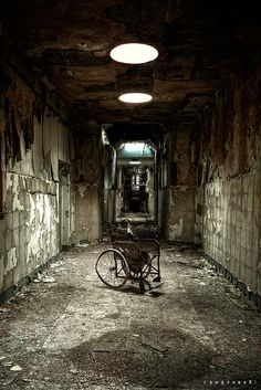Wheelchair in asylum D (UK). The place closed down in the late 1990s, at a age of 150 By [AndreasS] via flickr