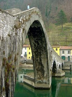 """Ponte della Maddalena (Italian: """"Bridge of Mary Magdalene"""", also known as Ponte del Diavolo, the """"Bridge of the Devil"""") is a bridge which crosses the Serchio river near the town of Borgo a Mozzano in the Italian province of Lucca. It was a vital river crossing on the Via Francigena, an ancient road to Rome for those coming from France and an important medieval pilgrimage route. The largest span is 37.8 m."""