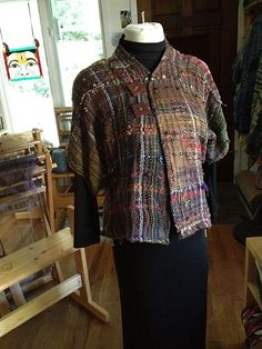 Those buttons could be used to close this. I like thier look.Ravelry: nickolena's saori handwoven blouse/jacket